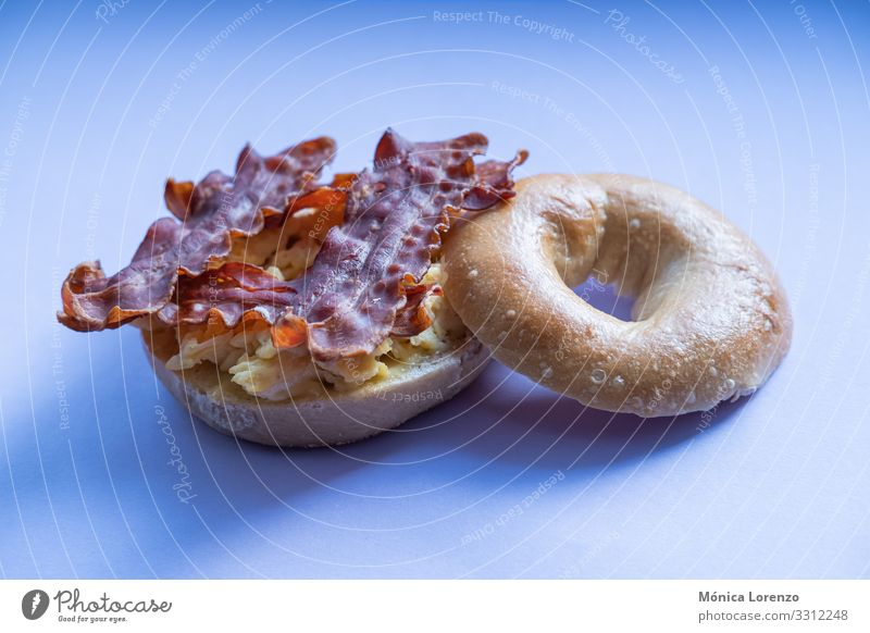 Bacon and scrambled eggs bagel isolated on purple background. Cheese Dough Baked goods Bread Eating Breakfast Diet Stove & Oven Fresh Smoked fish roll grain