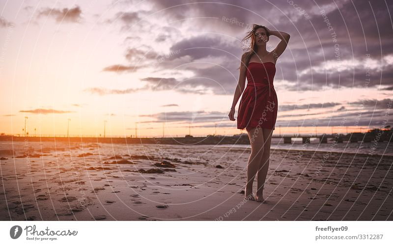 Woman in a red dress walking by a beach at sunset Luxury Elegant Style Beautiful Wellness Relaxation Fragrance Vacation & Travel Summer Beach Ocean Human being