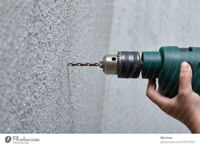 Worker drilling a hole into the wall with an electric drill. Flat (apartment) House (Residential Structure) Work and employment Tool Man Adults Hand Make Hole