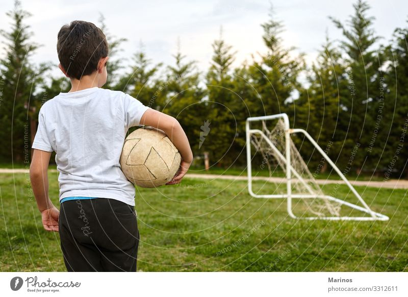 kid holding a soccer ball on garden field. Lifestyle Joy Happy Playing Sports Soccer Child Human being Boy (child) Man Adults Grass Happiness Green football