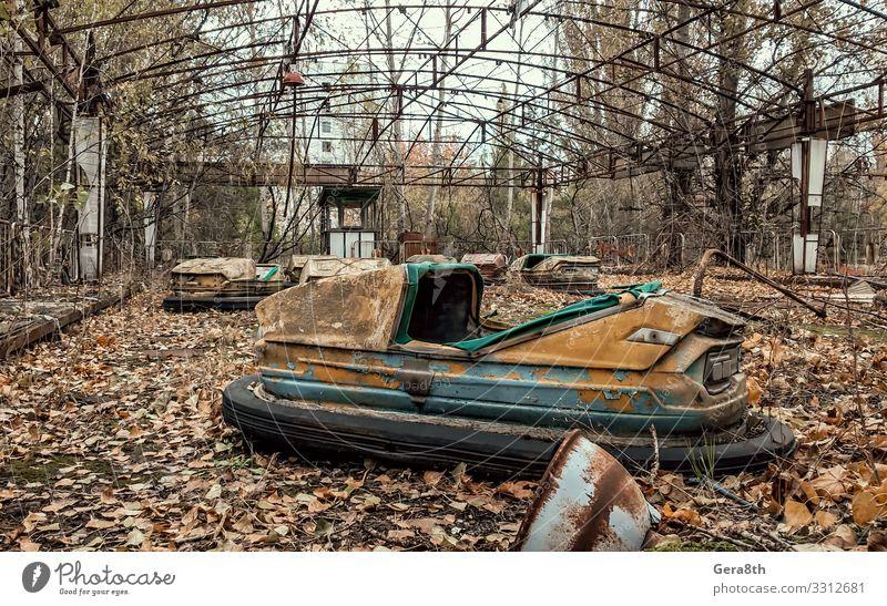 abandoned amusement park in Chernobyl Ukraine Plant Autumn Tree Leaf Park Metal Rust Old Acceptance Dangerous Environmental pollution Destruction accident