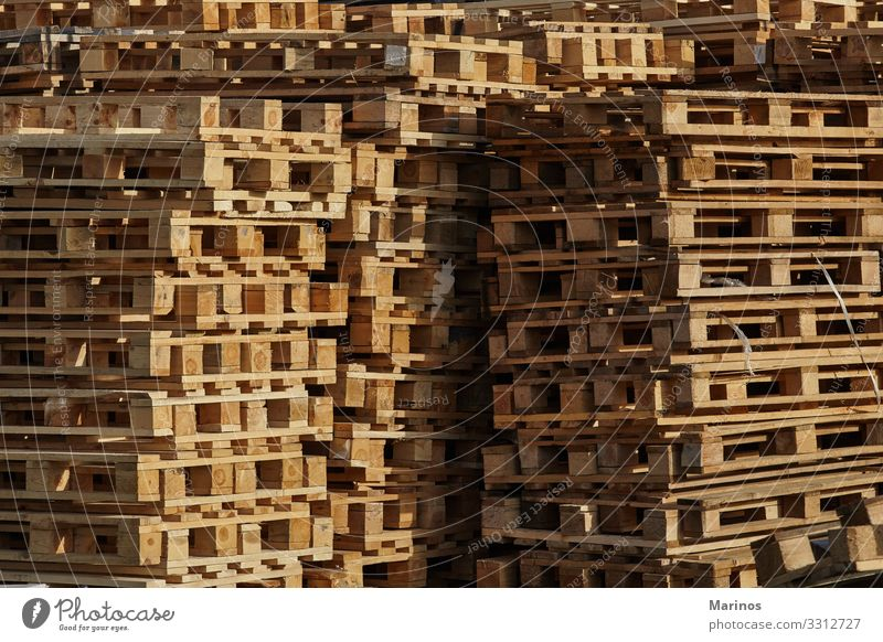 Stack of pallets outdoors. Work and employment Profession Factory Industry Transport Package Wood Society Industrial Warehouse background Consistency equipment