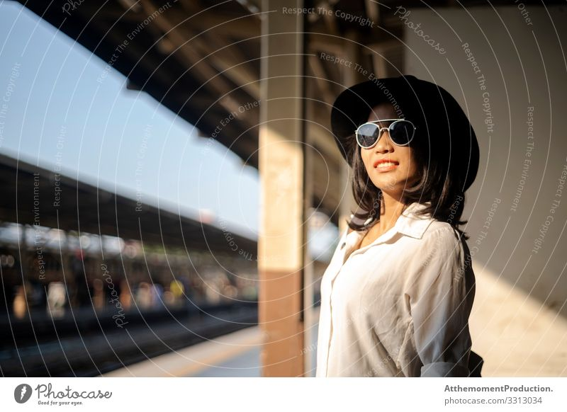 Black hat woman at train platform. Lifestyle Joy Happy Beautiful Relaxation Calm Leisure and hobbies Vacation & Travel Tourism Trip Adventure Freedom Summer