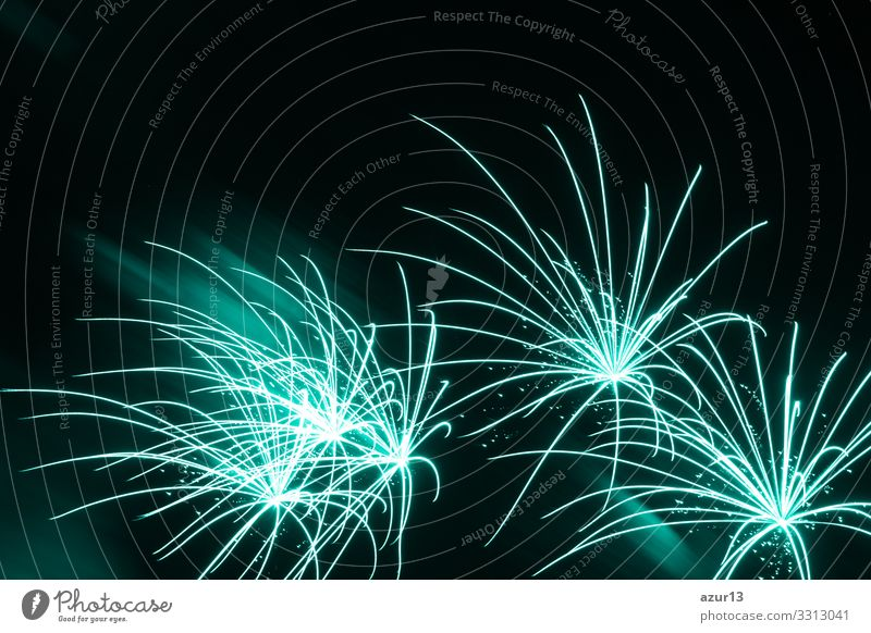 Luxury fireworks event sky show beautiful fine turquoise stars. Entertainment star firework with black dark night background. Night life Party Event Music