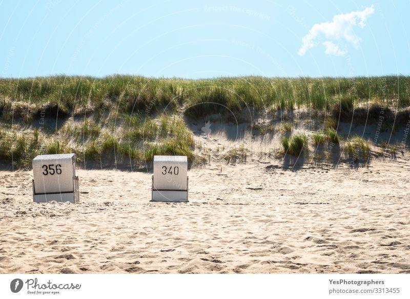 Beach chairs on the beach and grassy dunes on Sylt island Relaxation Summer Summer vacation Sand Coast North Sea Hot Frisian island German beach Germany