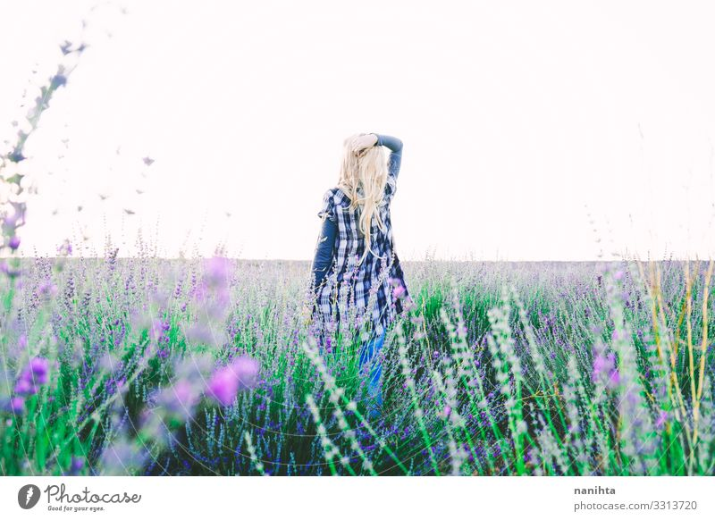 Young blonde woman alone in a lavender field Woman Human being Nature Youth (Young adults) Young woman Summer Beautiful Flower Loneliness Calm Far-off places