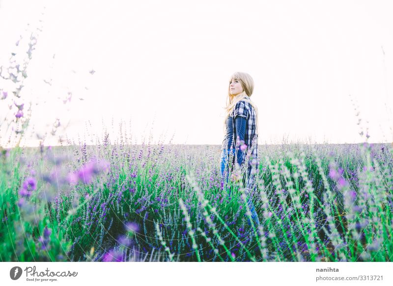 Young blonde woman alone in a lavender field Beautiful Life Freedom Summer Garden Gardening Woman Adults Environment Nature Spring Flower Agricultural crop