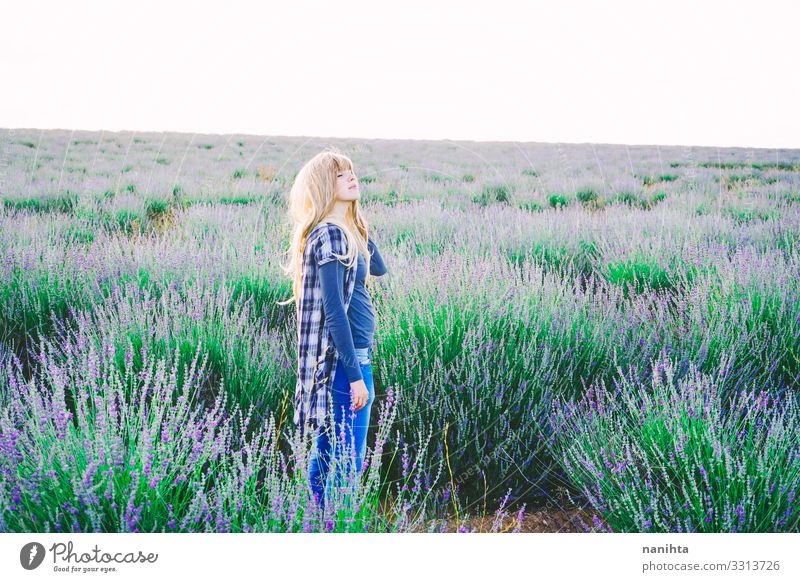 Young blonde woman alone in a lavender field young nature life garden gardening parfum spring springtime flowers lovely freedom candid real real woman summer