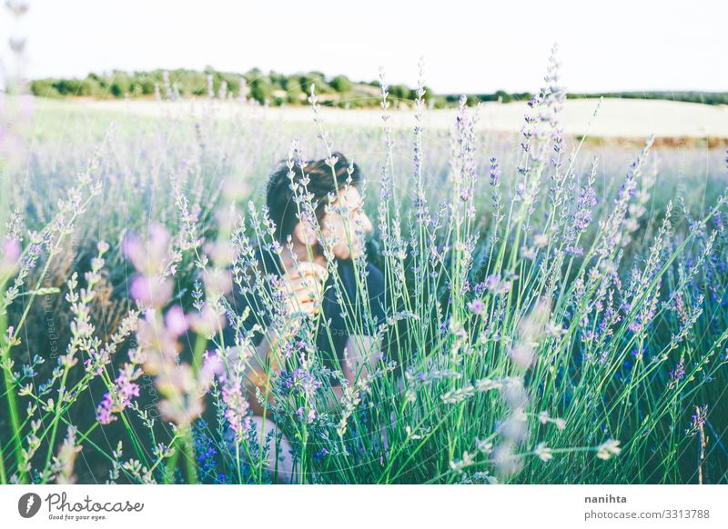 Young man in a field of flowers Face Relaxation Calm Sun Human being Masculine Man Adults 18 - 30 years Youth (Young adults) 30 - 45 years Environment Nature
