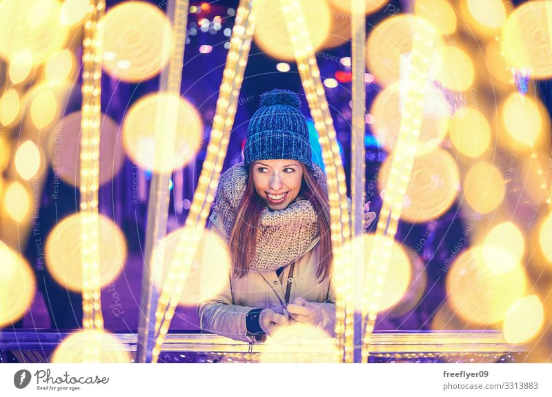 Portrait of a young woman enjoying christmas lights Lifestyle Beautiful Relaxation Winter Feasts & Celebrations Christmas & Advent Human being Young woman
