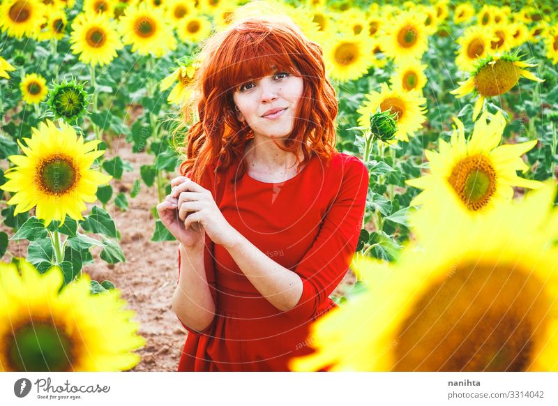 Lovely redhead woman enjoying the day in a field o sunflowers Lifestyle Style Joy Beautiful Freedom Summer Human being Feminine Young woman Youth (Young adults)