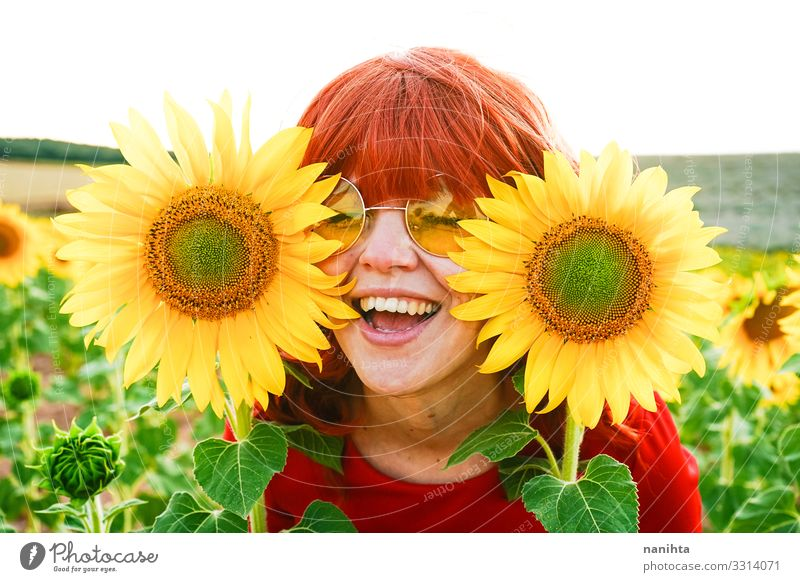 Lovely redhead woman enjoying the day in a field o sunflowers Lifestyle Style Joy Beautiful Freedom Summer Human being Feminine Woman Adults