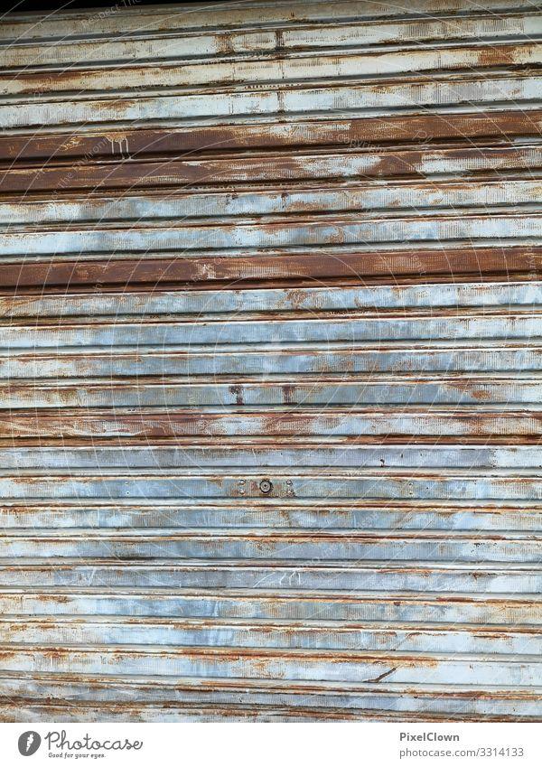 Gate from a garage Goal Garage Exterior shot Wall (building) Garage door Blue tambour door Brown dreariness Old Retro Deserted