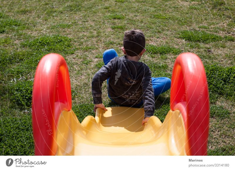 Child plays at playground with grass. Joy Happy Playing Garden Toddler Infancy Park Playground To swing Happiness Cute Green young kids area people cheerful