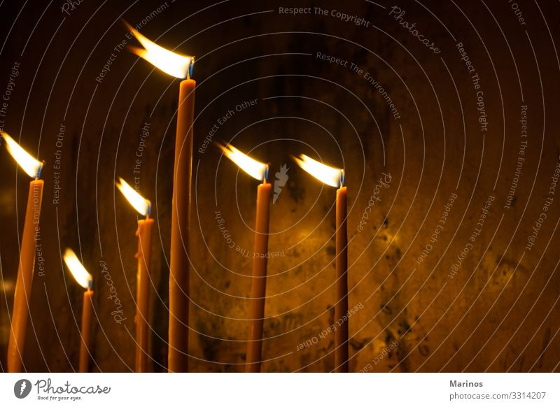 light candles in Orthodox church. Lifestyle Easter Christmas & Advent Feasts & Celebrations Hope lights Church Interior shot