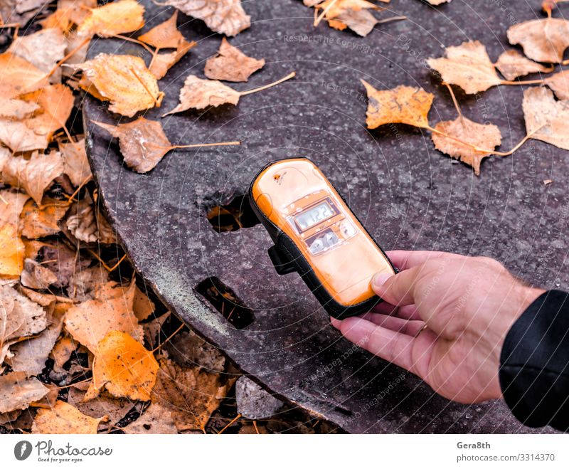 dosimeter device in hand near an radioactive object in Chernobyl Vacation & Travel Tourism Trip Man Adults Hand Nature Autumn Leaf Street Metal Old Threat