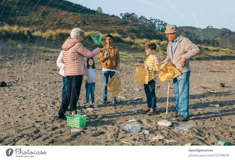 Volunteers preparing to clean the beach Woman Child Human being Man Old Beach Adults Environment Family & Relations Boy (child) Group Sand Dirty Clean Trash