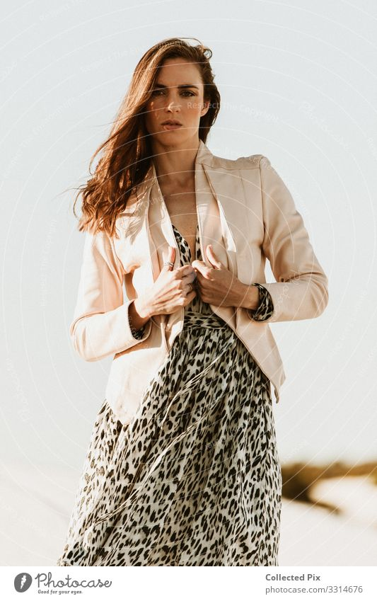 Successful woman wearing leopard print dress and pink jacket Lifestyle Luxury Elegant Style Design Joy Money Beautiful Vacation & Travel Trip Going out