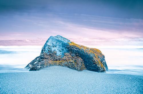 Blue stone on the beach Environment Nature Elements Sand Water Sky Horizon Moss Garden Coast Ocean Stone Orange Turquoise White Colour Creativity