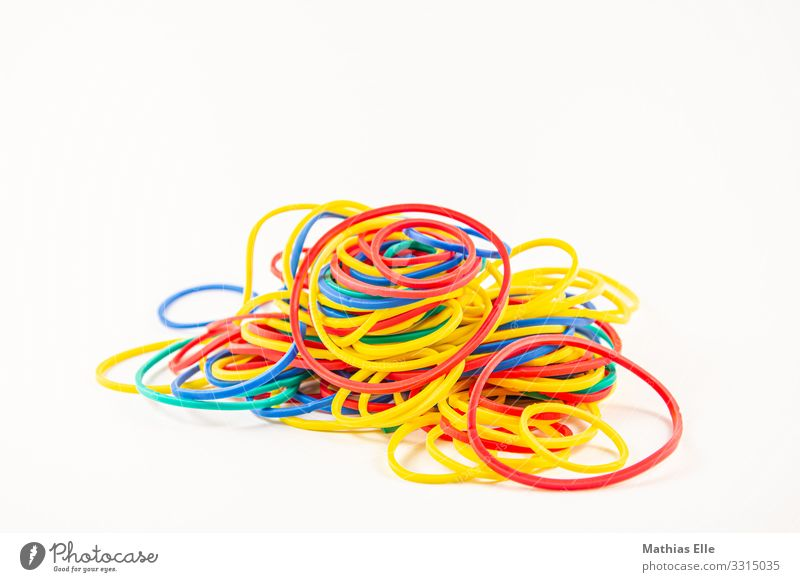 Coloured rubber bands elastic band Rubber Colourful rubber Blue Multicoloured Yellow Red Business Chaos Arrangement office Colour photo Studio shot Deserted