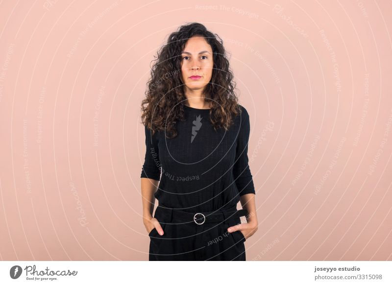 Brunette woman looking serious at the camera. 30 - 45 years attitude Beauty Photography Brown Casual clothes dressed in black Elegant empowerment Equality