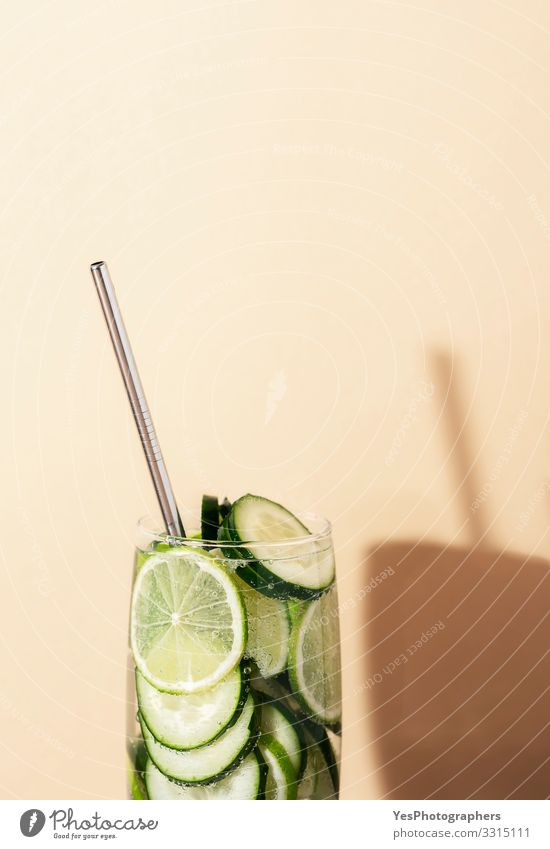 Lemonade glass with cucumber and lime. Summer cocktail Beverage Cold drink Drinking water Green antioxidant Air bubble Copy Space cucumber drink detox drink