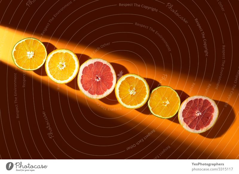 Sliced citrus fruits in sunlight. Oranges and grapefruits Fruit Organic produce Healthy Eating Summer vacation above view citrous Citrus fruits colorful