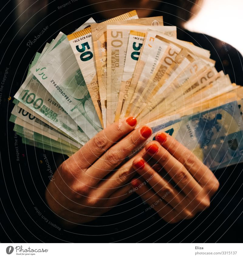 Hands that hold a lot of banknotes fanned out: wealth, fortune, savings. Human being Feminine Fingers Money Generous Loose change Many Bank note assets Euro