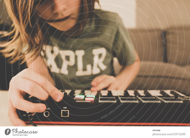 Boy at the keyboard Joy Skin Leisure and hobbies Playing Entertainment Party Music Clubbing Keyboard Sound Technology Entertainment electronics Child