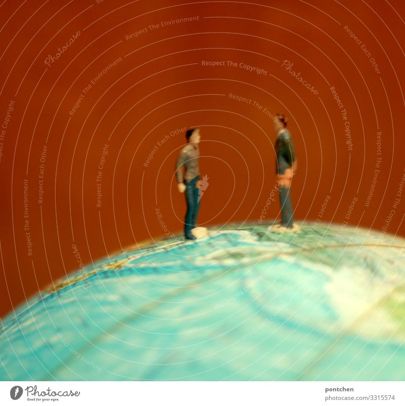 Fight. Two playing men face each other on a globe. Earthman Human being Masculine Homosexual Young man Youth (Young adults) Man Adults Couple Partner Life 2