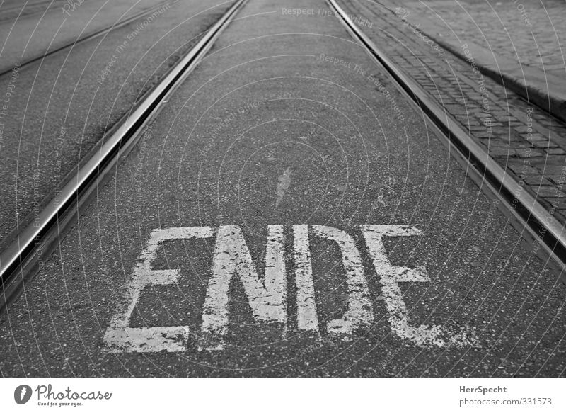 This is the ENDE Town Characters Gloomy Black White End Rail transport Railroad tracks Tram Lettering Road sign Letters (alphabet) Pavement Street