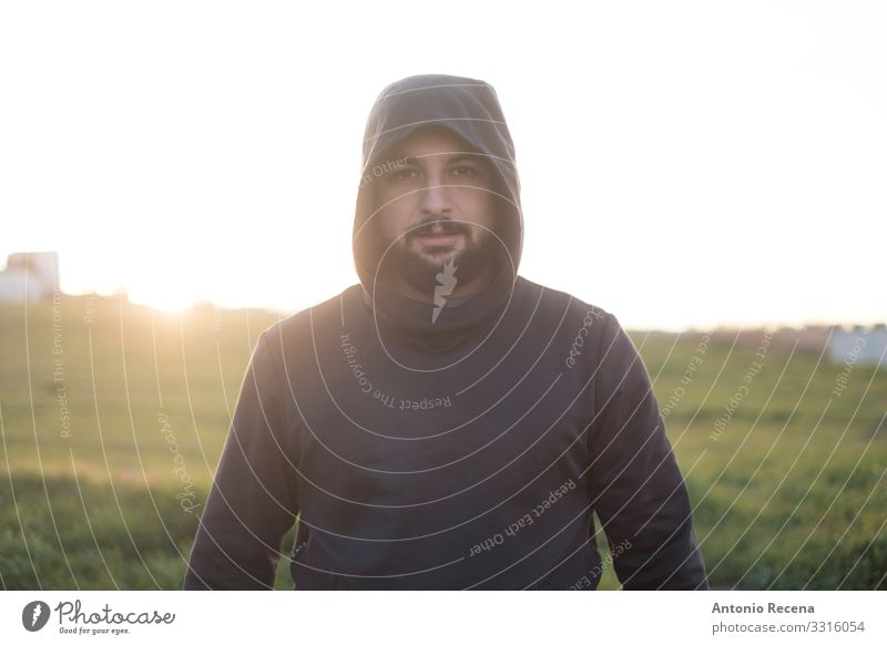 Bearded runner resting after training outdoors Lifestyle Sports Human being Man Adults Fitness Stand Serene Mysterious Runner sportsman hood Arabia