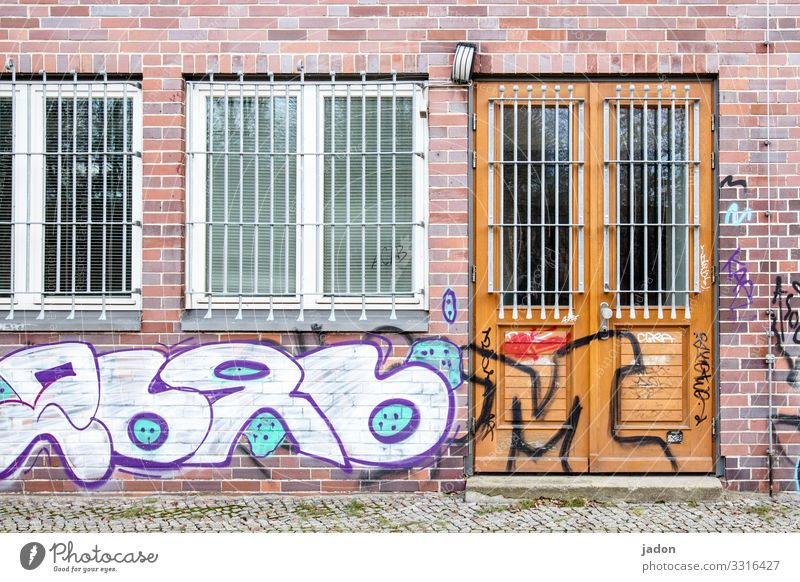 Town House (Residential Structure) Window Architecture Graffiti Wall (building) Building Wall (barrier) Facade Door Glass Sign Manmade structures Steel Brick