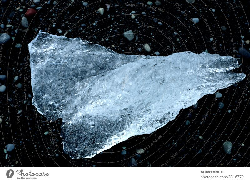 big ice crystal on the black sand at Jökulsarlon Ice Ice crystal iced lump Diamond Beach Crystal Black Frozen Jökulsárlon Crystal structure Exterior shot Melt