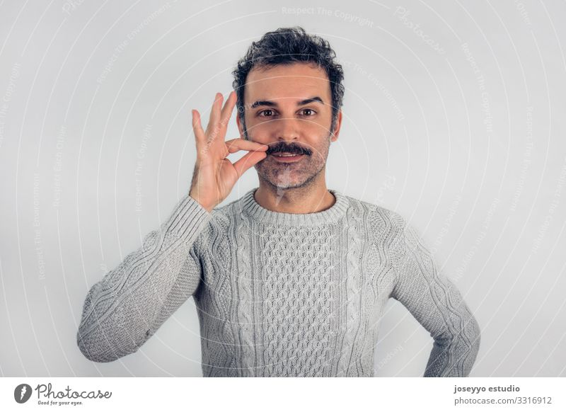 Brown, smiling, handsome man touching his mustache Adults Attractive Beauty Photography Cancer Casual clothes Cheerful Self-confident Copy Space Expression Face