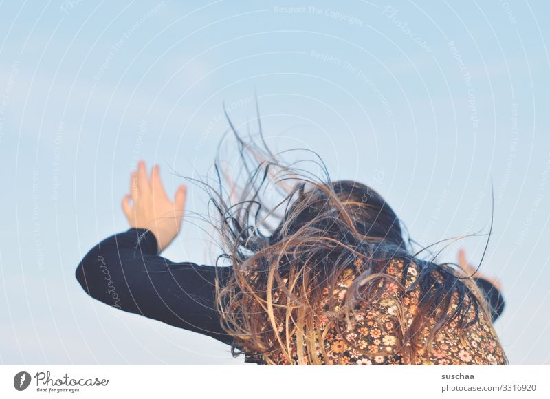 before the handstand Child Girl Rear view Hair and hairstyles Movement Dynamics Snapshot Arm Hand Wild fluttering hair Sky Exterior shot