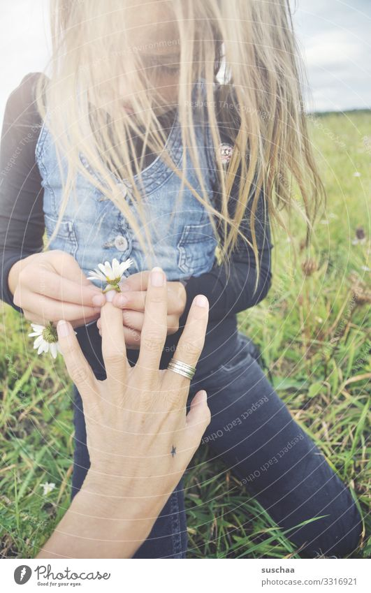 ring of flowers ... Child Girl Infancy Hair and hairstyles Wind Exterior shot Flower Flower meadow Daisy Marguerite Chamomile Meadow flower Hand Fingers Ring