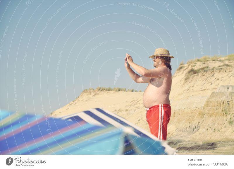 mr. k. photographed Vacation & Travel Summer Sun Beach Beach dune Sand Coast Man Photographer Stomach Swimming trunks Sunshade Blue sky Ocean Beach vacation