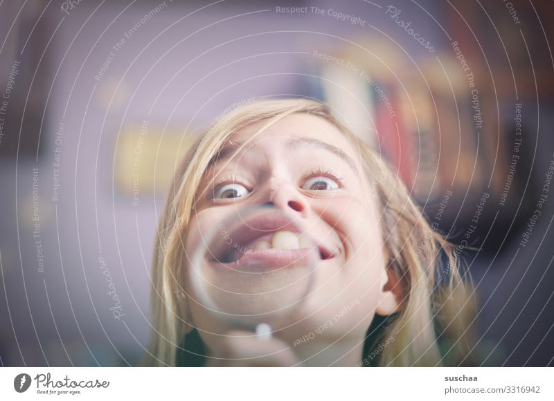 a case for the orthodontist Child Girl Head Face Grimace Funny Looking Distorted Magnifying glass Enlarged Joy Detail Crazy Funster Absurdity Excitement