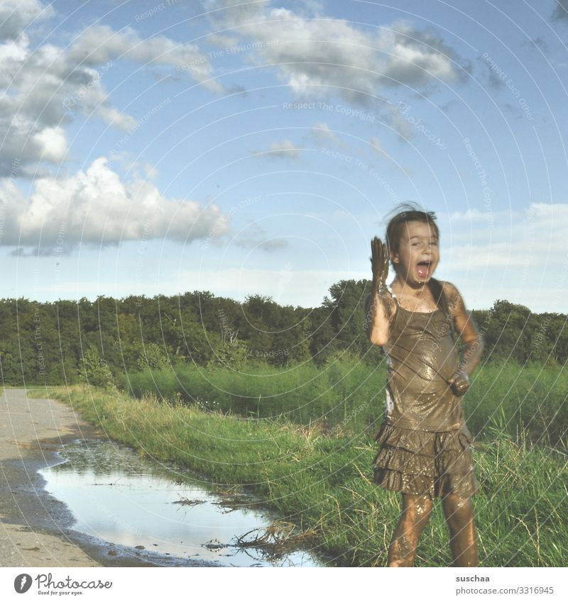 Be happy Child Girl Infancy Freedom Happy Playing Dirty Mud Puddle Exterior shot Nature Footpath Sky Joy Joie de vivre (Vitality) Swinishness sawn in Parenting