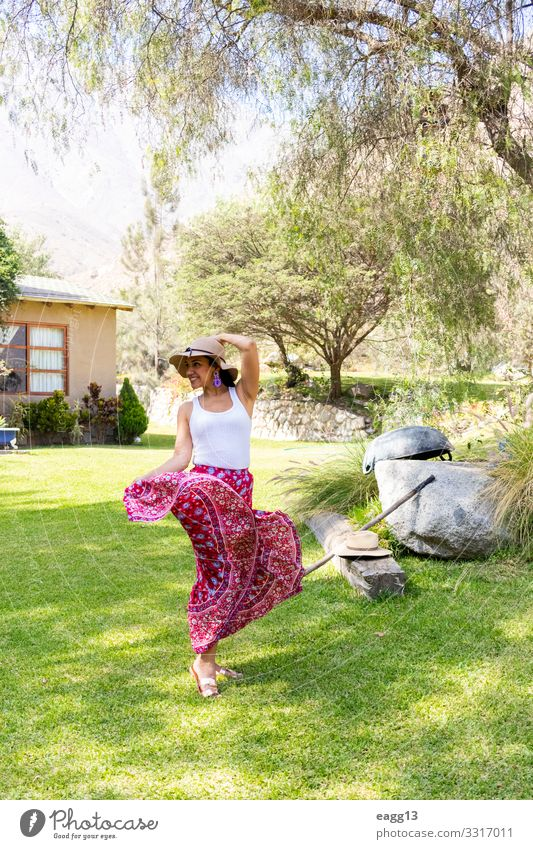 Pretty woman dancing flamenco in the garden of the house Woman Human being Vacation & Travel Summer Beautiful Tree Flower House (Residential Structure) Face