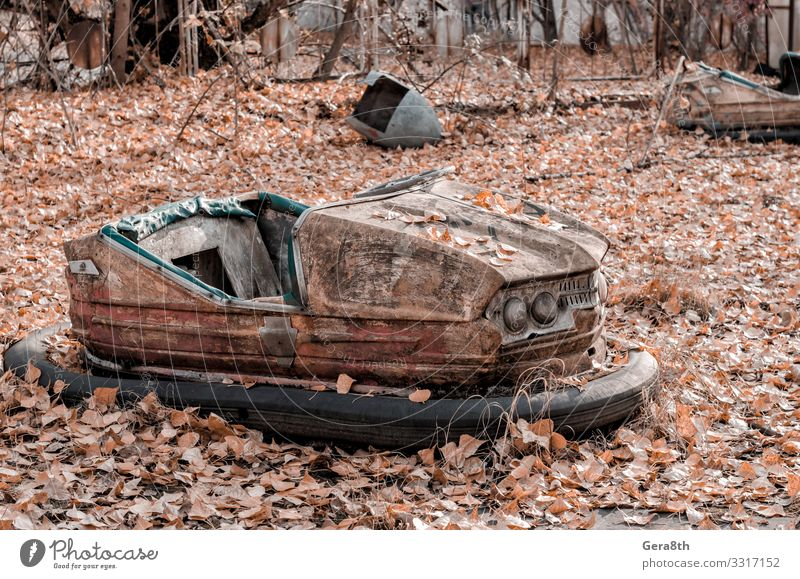 rusty car in an abandoned amusement park in Chernobyl Ukraine Vacation & Travel Tourism Trip Nature Plant Autumn Tree Leaf Park Transport Car Rust Old Threat