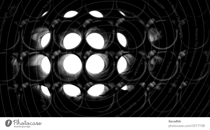 abstract dark background of round pipes Metal Dark Gloomy circle Geometry Hole Industrial iron light Monochrome Repeating Technical Black & white photo Abstract