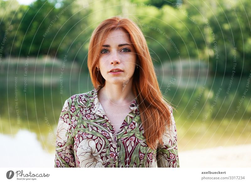young woman in summer dress at the lake Young woman Lifestyle Red-haired Nature Lakeside Elegant Style already Leisure and hobbies Human being Feminine