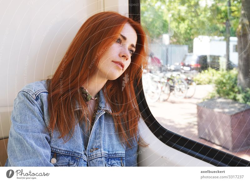 young woman sitting in tram looking out of the window Lifestyle Vacation & Travel Trip Human being Young woman Youth (Young adults) Woman Adults 1 18 - 30 years