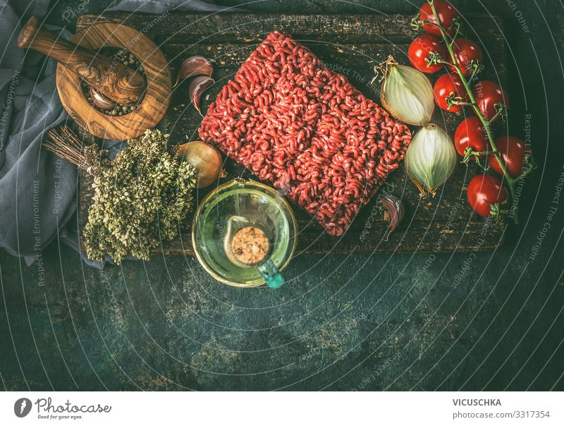 Raw minced meat with cooking ingredients Food Meat Vegetable Herbs and spices Cooking oil Nutrition Organic produce Crockery Design Living or residing Kitchen