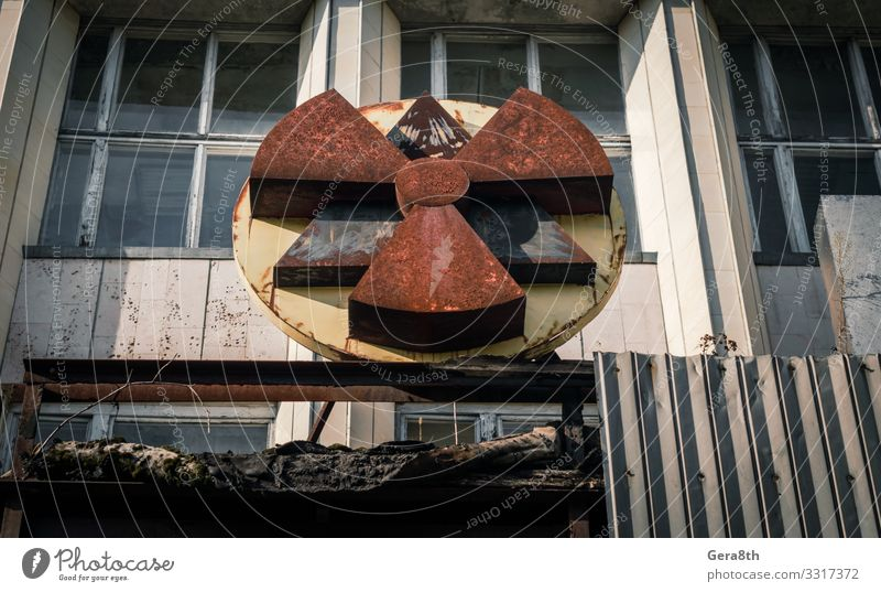 radioactive symbol on the facade of the building in Chernobyl Vacation & Travel Tourism Trip Autumn Building Architecture Rust Old Threat Disaster