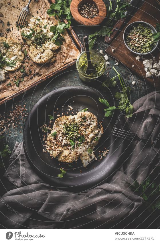 Cauliflower steak with kale pesto and pine nuts Food Vegetable Herbs and spices Organic produce Vegetarian diet Diet Crockery Plate Design Healthy Eating