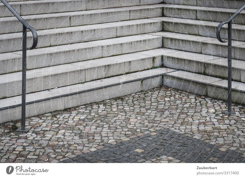 ruling Berlin Town Deserted Places Stairs Banister Paving stone Cobblestones Stone Concrete Sharp-edged Gloomy Gray Orderliness Boredom Arrangement Divide