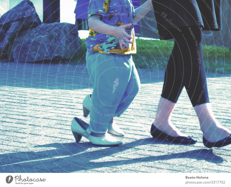 Feet of a woman and child wearing shoes that are too big foot Woman Child Adults Footwear Legs Asphalt Street High heels Exterior shot Multicoloured at large